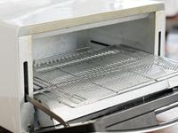 温度が下がらないように素早くピザを投入